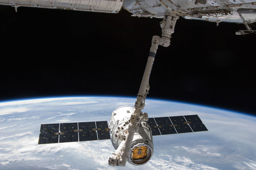 SpaceX Dragon spacecraft orbiting Earth