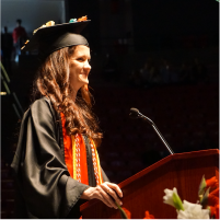 Nora giving valedictorian speech at commencement 2019
