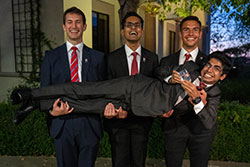 The winning team of SDSU students enjoy their victory. Front: Satya Bhambhani, Back, from left: Jack Kagan, Ashrith Reddy and Juan Francisco Frias Carazo.