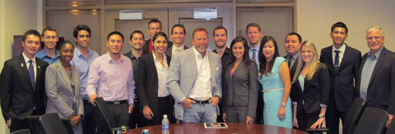 Business and hospitality students met with Stephen Cloobeck (center) at the Lavin Entrepreneurship Center