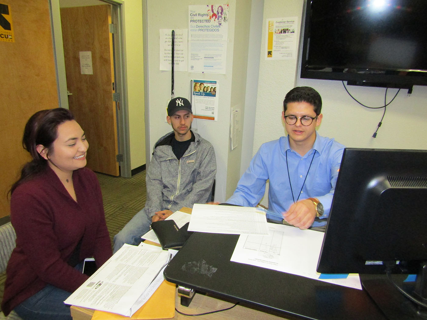 SDSU student, Alejandro Preciado, helps prepare taxes at the IRC's El Cajon location