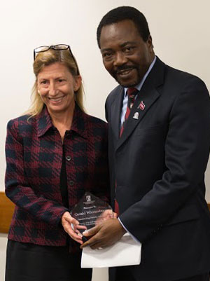 Devona Newport accepts the award from SDSU provost Chukuka Enwemeka