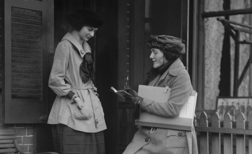 Two women performing the old fashioned census.