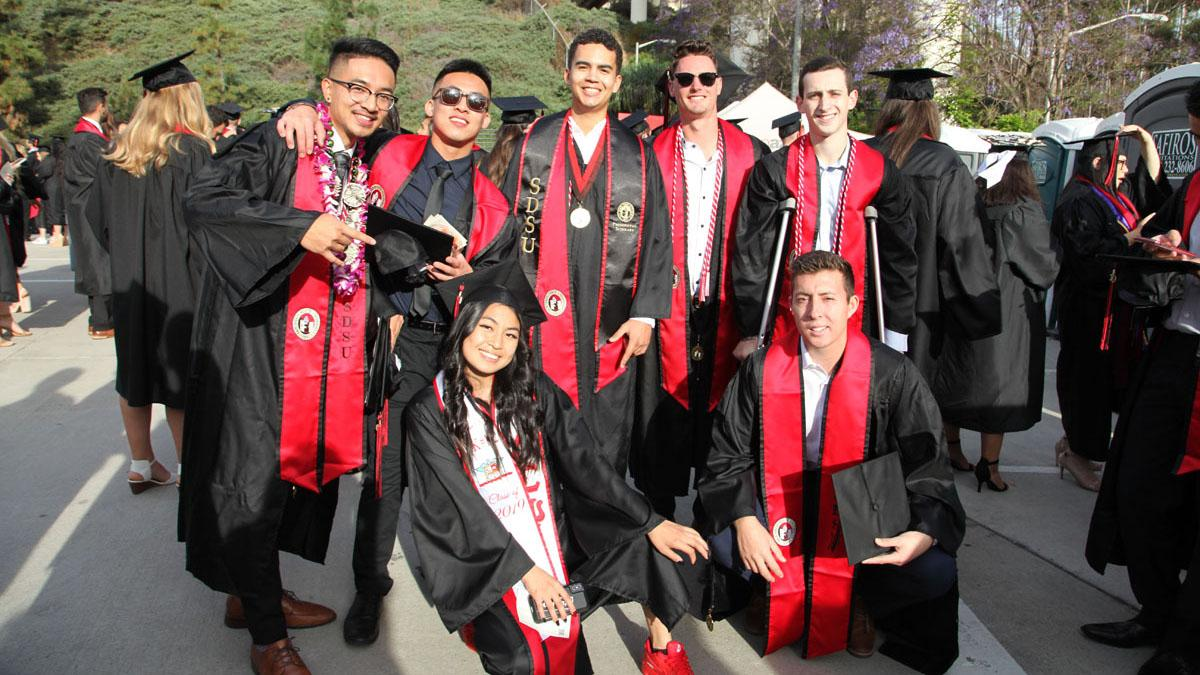 Group photo of students in graduation gowns