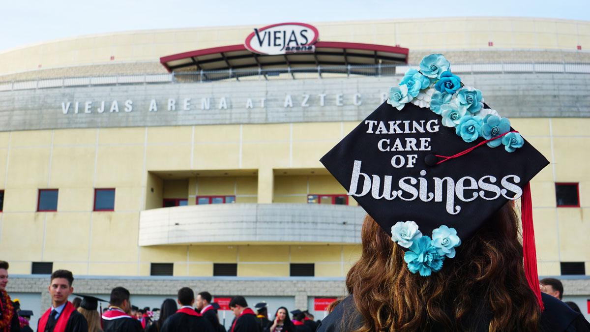 Graduation cap that says 'Taking care of business'