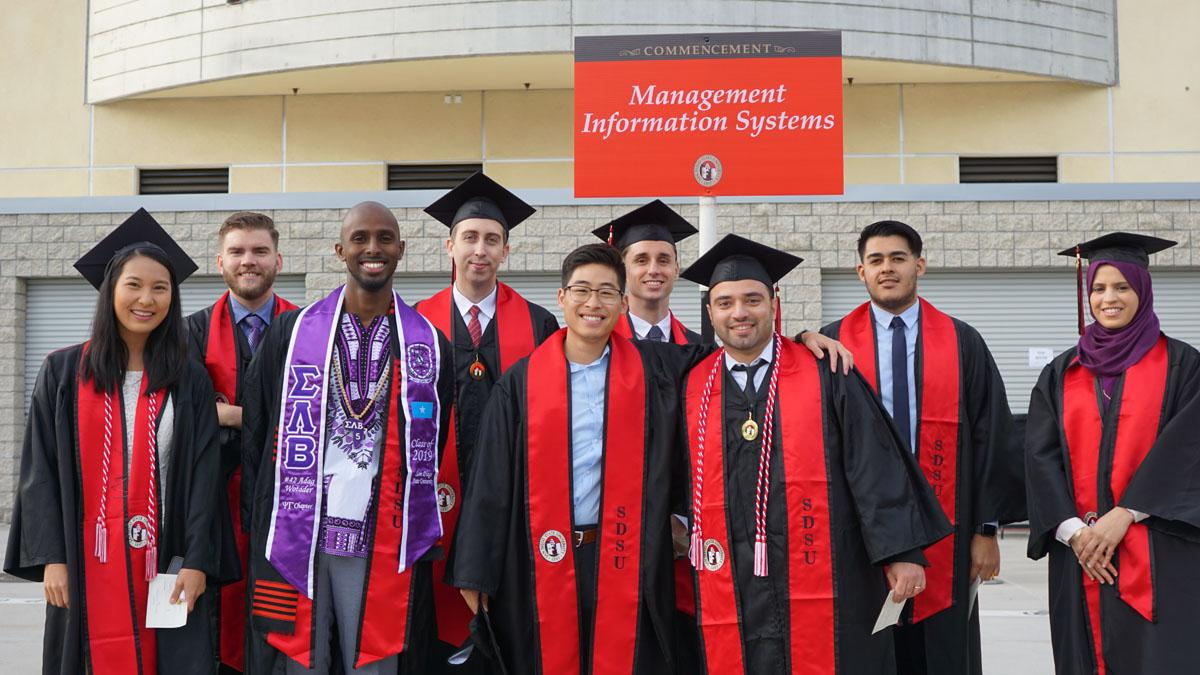 Management Information Systems students in graduation gowns