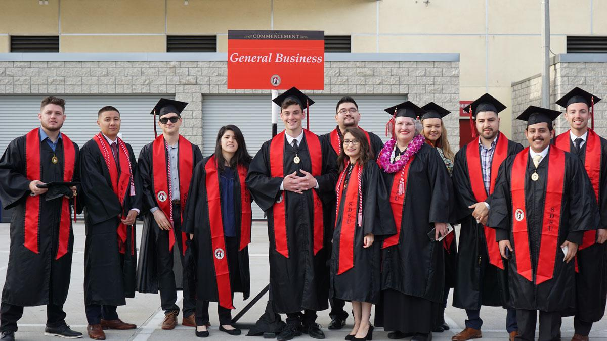General Business students in graduation gowns